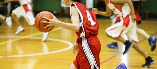 Dribbling up the court in a youth basketball game